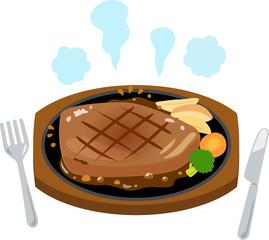 鉄板焼きのステーキとナイフ、フォーク