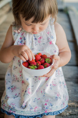 ripe strawberry in the hands of a close-up child
