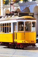 Lisbon, Portugal yellow tram, icon symbol of the city