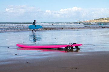 Surfboards on the shores of the Atlantic Ocean. Photo travel. Leisure. Surfing