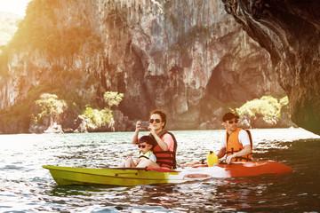 Family tourism travel kayak kayaking concept sea vacations