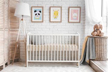 Modern baby room interior with crib