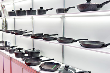 Modern cooking pans in store