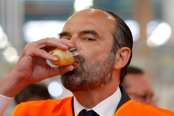 French Prime Minister Edoaurd Philippe drinks a coffee during a visit at the Groupe Seb Moulinex factory in Mayenne