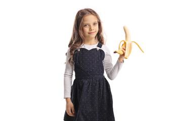 Little girl holding a banana