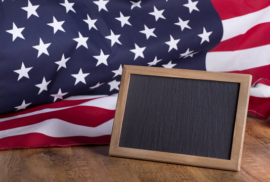 Blank blackboard for copy space and American Flag in background