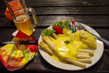 German traditional asparagus with salad and potatoes under sweet souse