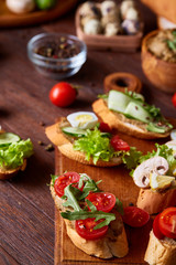 Breakfast sandwich with homemade paste, vegetables and fresh greens, shallow depth of field