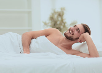 successful man wakes up in a new house