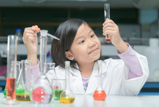 Happy little scientist making experiment