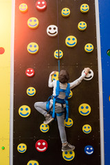 Jumping from boulder to boulder and never falling, with a heavy pack, is easier than it sounds! Picture of the little kid climbing the wall with smiles as a sort of fun.