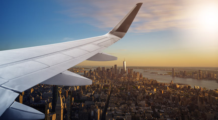 Aerial New York City with airplane wing