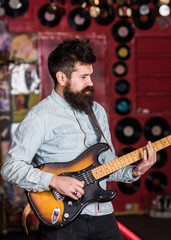 Instrumentalist concept. Musician with beard play electric guitar