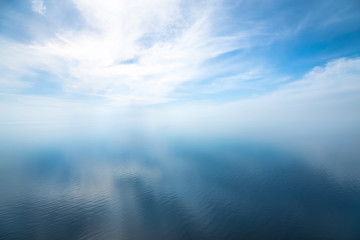Beautiful seascape in the Atlantic ocean. Seascape with cloudy sky and light shadows on the water