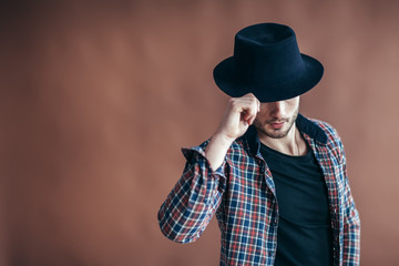 Young hipster man wearing hat posing with copy space