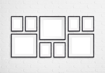 Black wooden photo frames mockup, nine pieces set collection isolated on white bricks wall , 3d illustration