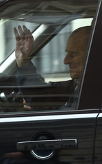 Britain's Prince Philip waves as he is driven away from King Edward VII's Hospital where he recently underwent hip replacement surgery, in central London