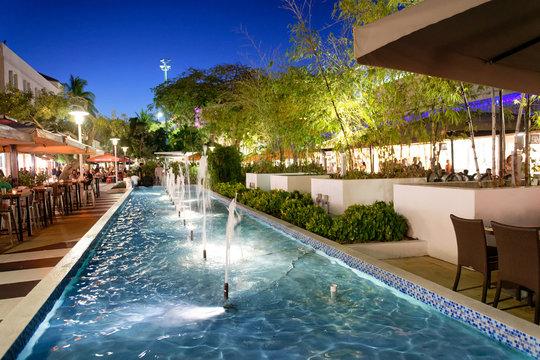 MIAMI BEACH, FL - MARCH 30, 2018: Tourists in Lincoln Road at night. Miami Beach is a famous tourist attraction