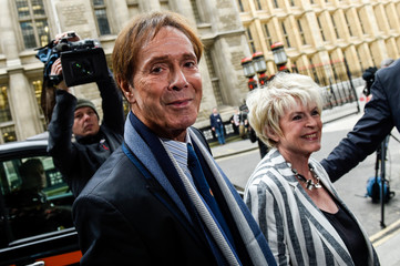 Cliff Richard and Gloria Hunniford arrive at the High Court in London