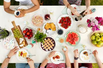 Friends having outdoor meal