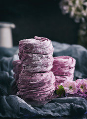 a stack of marshmallows with black currants