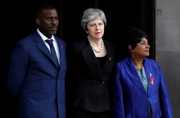 Britain's Prime Minister Theresa May stands with Doreen Lawrence as she arrives at a service at St Martin-in-The Fields to mark 25 years since her son Stephen Lawrence was killed in a racially motivated attack, in London