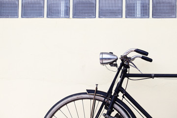 old classic bicycle on retro vintage wall