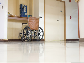 wheelchair parking in the front of blue public telephone in hospital. Wheelchair accessible for elderly or sick people.