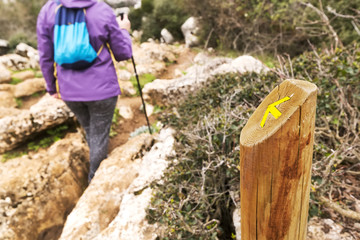 Hiker woman walking in mountains , Torcal in Antequera city  , Spain
