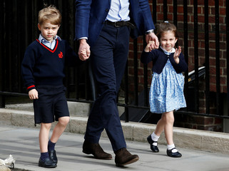Britain's Prince William arrives at the Lindo Wing of St Mary's Hospital with his children Prince George and Princess Charlotte after his wife Catherine, the Duchess of Cambridge, gave birth to a son, in London