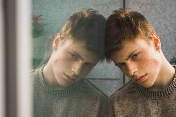Sensual young man with freckles