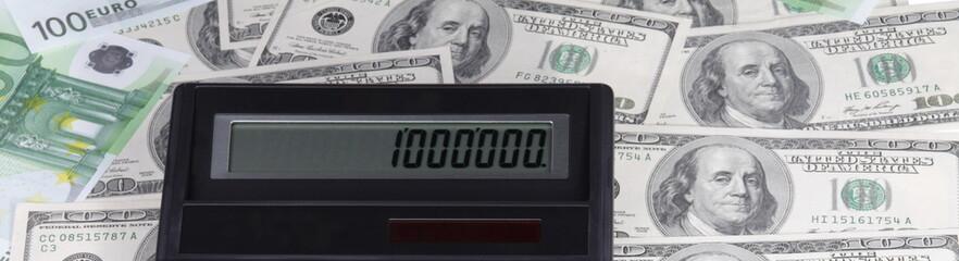 dollar, euro banknote and calculator
