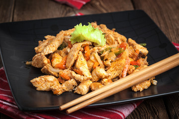 Fried chicken pieces with vegetables.