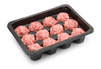Plastic tray with raw beef meatballs