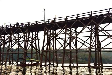 Silhouette of Wooden Mon Bridge During Sunset in Sangkhlaburi, Thailand