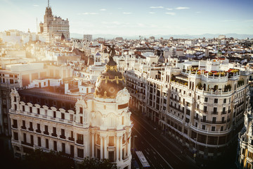 Cityscape of Madrid at sunset, with Gran Vía street.