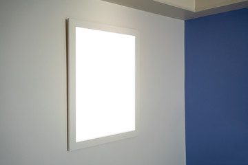Photo frame hanging on white wall in modern interior design.