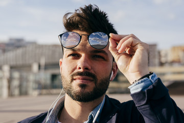 Bearded man in sunglasses looking up