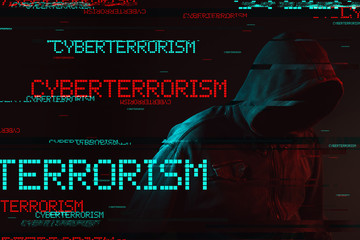 Cyberterrorism concept with faceless hooded male person
