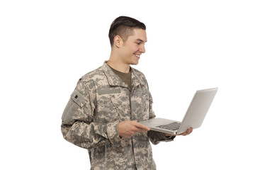 Side view of soldier with laptop