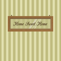 Wooden frame hanging on the background of striped wallpaper. Home Sweet Home