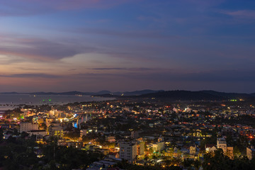 Aerial night scape view of Duong Dong town on Phu Quoc Island in Vietnam, streets with lights and bay