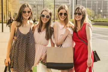 Smiling girls doing shopping
