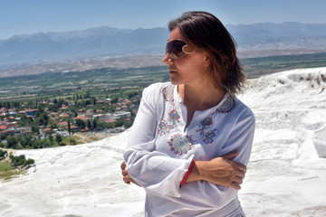 Tourist in white clothes in Pamukkale