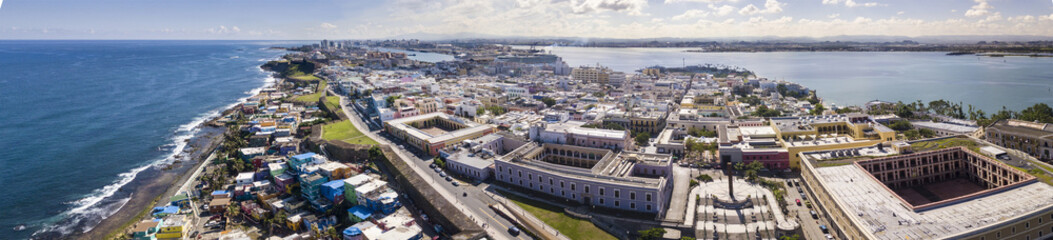180 degree aerial panorama of Old San Juan, Puerto Rico with harbor in the background.