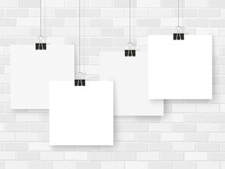 Posters on binder clips. White notepad paper templates. Business. Brick wall. Canvas. Interior. Realistic vector illustration. Empty mockup frames for your drawings, quotes or lettering.
