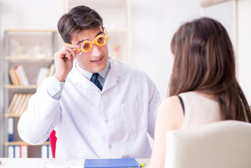 Ophthalmologist is checking up patient in eye doctor hospital