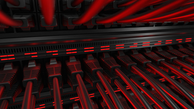 Close-up view of modern internet network switch with plugged ethernet cables. Blinking red lights on internet server.