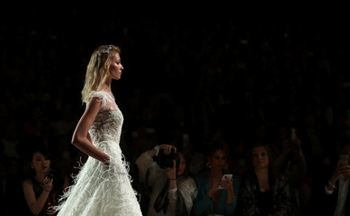 A model presents a wedding dress of Pronovias during the Barcelona Bridal Week