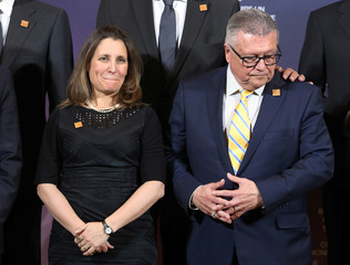 Canada's Minister of Foreign Affairs Chrystia Freeland and Canada's Minister of Public Safety Ralph Goodale wait for a group photo to be taken